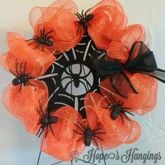 Happy Halloween!  #Halloween #Halloweenwreath #scary #spooky #deco #spider #decomesh #orange #spiders #orangewreath #spiderwreath #orangeandblack #wreaths #hopeshangings #Fayetteville #fayettevillenc #fortbragg #fortbraggnc #happyhalloween