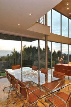 Ancient Oregon Relic Now Super Modern Home! Dining Nook, Dining Room Design, Minimalist Dining Room, Minimalist Office, Recessed Ceiling Lights, Glass Top Dining Table, Beautiful Dining Rooms, Stunning View, Dining Furniture