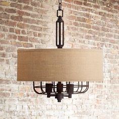 Influenced by the handsome minimalism of the industrial age, this pendant light features a deep bronze finish and burlap drum shade.