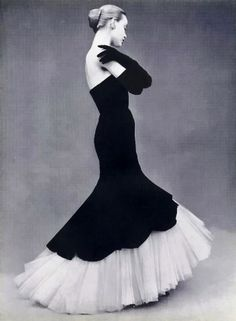 Model wearing a gown by Balenciaga, 1951. I could never pull this off comfortably, but the visual just makes me so happy.