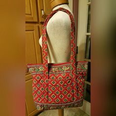 Vera Bradley Handbag This Vera Bradley purse was produced from July 2004 & retired in July of 2005.  The pattern is called Villa Red.  It has been used but is in great condition.   No tares or stains but does have normal wear.  The 4 pictures are of the front,  back, bottom & inside.  Please examine the pictures closely & ask any questions you might have before purchasing. Vera Bradley Bags Shoulder Bags