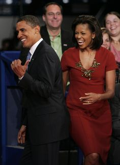 Happy days are here again!   President Obama and his wife enjoy a good laugh together.