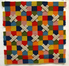 From Britt-Marie Christoffersson. All garter stitch. Love the 3-dimensional effect of the garter strips as a replacement for blocks. Appears to be a wall hanging.