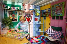 The shed is made up of pallets, doors, polycarbonate roof and reclaimed paving slabs, maki. Recycled Door, Crafts From Recycled Materials, Man Cave And She Shed, Potting Station, Shed Of The Year, Garden Workshops, Large Sheds, Paving Slabs, She Sheds