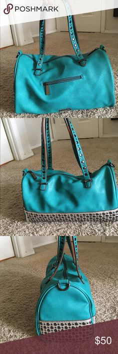 Youmi K  Studded Purse Beautiful Turquoise studded purse by Youmi K. This is a brand sold by Buckle and it is in a great shape. Only used a couple times. No visible wear and tear. Looks great with all colors! youmi k Bags Shoulder Bags