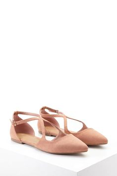 A pair of faux suede flats featuring a strappy cutout top, high-polish buckle closure and a pointed toe.