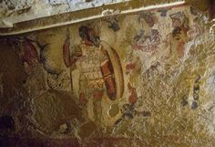 Ancient Etruscan fresco of Hades and Persephone leading a procession. Tomb of Orcus II, Tarquinia, Italy.