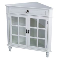 This Heather Ann Wooden Corner Cabinet will enhance any space. Each corner cabinet features a single drawer and two doors with mirror insert. The cabinets are hand-crafted and hand-finished, so no two are exactly alike.