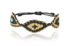 http://zoekompitsi.com/project/black-gold-eye-bracelet/