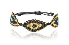 http://zoekompitsi.com/project/black-gold-eye-bracelet/