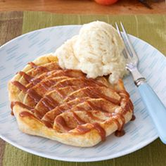 Thisdelectable dessertuses puff pastry shells to easily make pear or apple pastries drizzled with prepared carameltopping and served with vanilla ice cream.