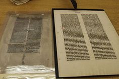 Rarities in Ellis Library | A manuscript leaf of the Acts of the Apostles (left) is compared to MU's leaf of the Gutenberg Bible (right). Photo by Imani Cobbs/Missourian | Vox Magazine, Columbia MO