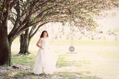 Bride in the cherry blossoms at the Crow Farm and Winery