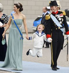 Crown Princess Mary, Prince Christian, and Crown Prince Frederik of Denmark attends the Wedding of Crown Princess Victoria of Sweden to Daniel Westling in June 2010