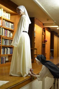 Catholic nun marking sister's habit for hemming. In case you ever wondered how nuns got their habits to fit.
