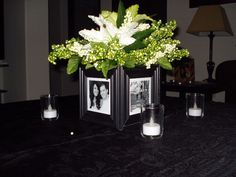 Glue 4 frames around a cube vase (1$ store).-auction decor. Rehearsal dinner idea