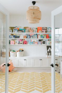 Playroom – with California Closets – white shelves, lots of books, and built. - Playroom – with California Closets – white shelves, lots of books, and built-in storage cabinet - California Closets, California California, Playroom Design, Playroom Decor, Playroom Ideas, Pottery Barn Playroom, Pottery Barn Baby, Playroom Organization, Kids Playroom Storage