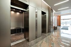 LEVELe Wall System with Blind panels in ViviChrome Chromis glass with custom color interlayer and Opalex finish, and LEVELe-105 Elevator Interiors at Mission City Corporate Center, San Diego, California