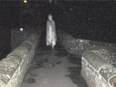 Ghost hunters from Cheshire Paranormal Society (CPS) took this photo during a vigil on the historic Packhorse Bridge in the village of Caergwrle, near Wrexham. At the time members hadn't realised what was apparently standing on the bridge in front of them, said John Millington from the group, but some group members had reported feeling uneasy. seen in this photo. With assistance from Hope and Caergwrle Heritage Society, it's thought 3 ghosts haunt the bridge; a young girl & 2 women.