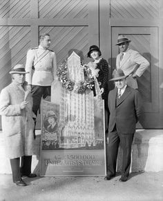 What About Bobbed? - J Barrymore M Pickford D Fairbanks DW Griffith and unnamed man at opening of United Artists Theatre at Broadway and Ninth, NYC, 1927