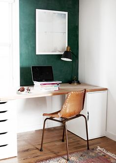A cozy modern schoolhouse office that doubles as a play area.
