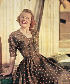 June Allyson, whose latest film is The Girl In White, approves of this dress with big-city ways and it's fake spencer jacket.