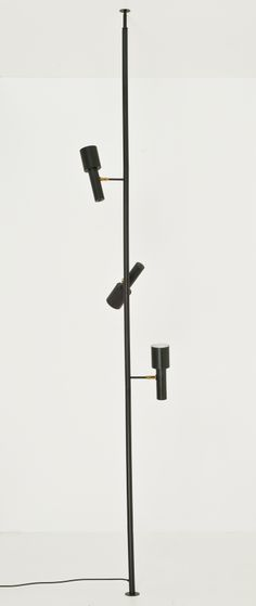 Anonymous; Enameled Metal and Brass Vertical Tension Light, c1960. I've owned several of these over the years with varying shade designs. I still have some..