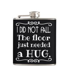 """Floor Hug Funny Hip Flask - A funny flask to explain those awkward falls. Makes a great gift. You can change the black background color to another color by selecting the """"Customize It"""" button and choosing another background color. Sold at DancingPelican on Zazzle."""