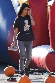 Kourtney Kardashian wearing J Brand Mid Rise Skinny Jeans in Chrome Mercy and Sol Sana Samuel II Boots in Python