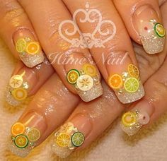 Citrus nail art. Interesting, though I don't think I'd enjoy typing or texting with nails like that...