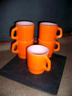 Vintage orange mugs on Etsy