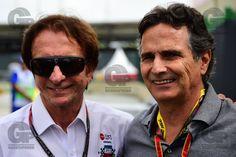 Os ex-pilotos brasileiros Emerson Fittipaldi (E) e Nelson Piquet no Autódromo Internacional José Carlos Pace (Interlagos), em São Paulo, durante o GP do Brasil 2014, de Fórmula 1.