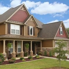 James Hardie Plank Lap Siding in Chestnut Brown and James Hardie Shingle Siding in Country lane Red.
