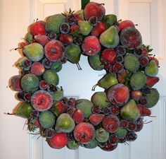 """I had such fun making this faux sugared fruit wreath.  Each piece of fruit is hand """"sugared"""" with glass microbeads then attached to a moss covered foam wreath.  I wish I had a large candle because it would make a beautiful table center piece."""