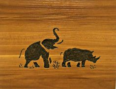 Elephant and Rhino carved wood wall decor by LittleEtrends on Etsy