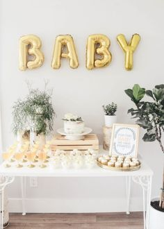 Need baby shower inspiration? This gorgeous Oh Baby theme set up is perfect! We love pairing metallic golds with greenery for the most effective baby shower set up! Baby Shower Simple, Décoration Baby Shower, Bebe Shower, Fiesta Baby Shower, Gold Baby Showers, Gender Neutral Baby Shower, Shower Party, Baby Shower Parties, Baby Shower Gifts