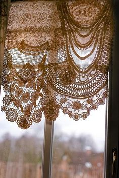 Lace Curtains made from joining a variety of laces, trims and delicate doiliesVintage French lace...