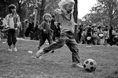 kids playing football in the park