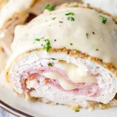Chicken Cordon Bleu – Spend With Pennies Tender chicken wrapped around slices of ham and swiss cheese, this Easy Chicken Cordon Bleu recipe a favorite. Baked instead of fried, this dish is simple to prepare and topped with a creamy dijon sauce! Chicken Cordon Bleu Sauce, Sauce For Chicken, Oven Baked Chicken, Chicken Recipes, Breaded Chicken, Grilled Chicken, Chicken Cordon Bleu Sandwich, Crusted Chicken, Chicken Pasta