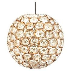 In a closet or powder room? Hanging pendant light with a layered shell shade.   Product: LampConstruction Material: ShellColor: GoldDimensions: 17 Diameter