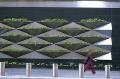 The wall mounted planters at Time Warner Center enhance the pedestrian level facade by incorporating landscaping on the vertical building surface. Photo courtesy Mathews Nielsen