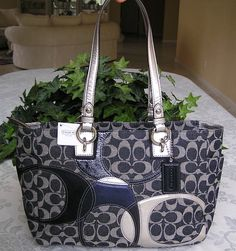 Look at this great Coach Signature Inlaid Patchwork Gallery handbag. This purse matches everything!