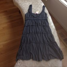 Velvet Gray/Grey Dress size S/M Easy flowing light weight dress. Lots of room here. Size small but will fit a medium. Person who took picture is a med/large....Low cut v front. Dress has tags but I think it must b a return bc it looks like it has been worn. Distressed comfy dress by VELVET Velvet Dresses Mini