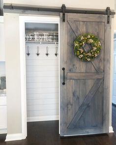 Entryway closet with barn door. The hooks are up and running! Now just to get the wood piece to replace the white shelf and a wood piece for the bottom! Don't forget, use… Home Renovation, Home Remodeling, Entryway Closet, Closet Doors, Mudroom, Closet Redo, Closet Remodel, Door Design, House Design