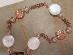Bracelet...handcrafted copper waves beads, disk pearls, and crystals