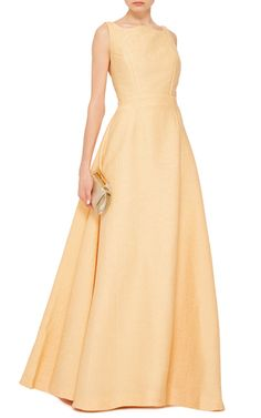 This **Emilia Wickstead** sleeveless gown features a scalloped neckline, an open back with camisole style straps, and a gathered, full skirt.