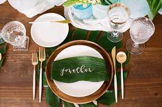 tropical leaf name card - photo by Krista Mason Photography http://ruffledblog.com/tropical-leaves-and-sea-glass-wedding-shoot