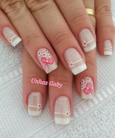 Simple and clean looking bow nail art design. Draw cute little pink bows with rhinestones on top and add flower designs to complete this adorable design.