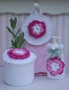 """PA687 Rose Radiance Bath Set Crochet Pattern- Brighten up your bathroom with this gorgeous Rose Radiance Bath Set. Patterns included are towel topper, toilet paper topper and soap dispenser cover. Size: Toilet Paper Topper – 5"""" tall and 6"""" wide; Soap Dispenser Cover – 7"""" tall, 3"""" wide and 2"""" deep; Towel Topper – 7"""" diameter."""