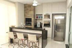 Cozinhas modernas com ilha https://www.homify.pt/livros_de_ideias/2538408/cozinhas-modernas-com-ilha-para-casas-pequenas
